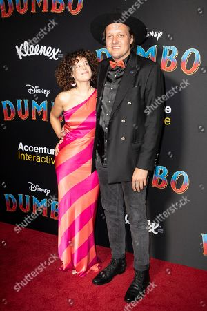Regine Chassagne (L) and husband US singer Win Butler (R) pose for the photographers as they arrive for the premiere of 'Dumbo' at the El Capitan Theater in Hollywood, California, 11 March 2019. The movie 'Dumbo' will start screening on 29 March 2019.