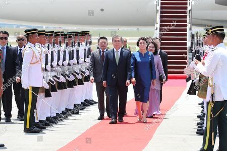 Stock Picture of South Korean President Moon Jae-in (L, front) reviews an honor guard with his wife, Lee Jung-sook (R, front), after arriving in Kuala Lumpur, Malaysia, 12 March 2019. Moon began his three-day state visit to Malaysia as part of his swing through Southeast Asian nations that included a prior trip to Brunei.