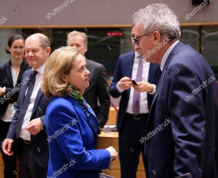 Spanish Economy Minister Nadia Calvino (L) and Luxembourg's Finance Minister Pierre Gramegna during the European Finance Ministers' meeting in Brussels, Belgium, 12 March 2019.