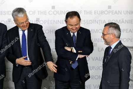 Belgium's Foreign Minister Didier Reinders (L) chats with Polish minister for European affairs Konrad Szymanski (C) and German Minister of State for Europe Michael Roth (R), as they pose for the family photo at the Informal Meeting of Ministers and State Secretaries for European Affairs, held at the National Bank Headquarters in Bucharest, Romania, 12 March 2019.