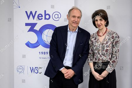 World Wide Web inventor Tim Berners-Lee (L) poses with European Centre for Nuclear Research (CERN) director general Fabiola Gianotti during an event marking 30 years of World Wide Web, at the CERN in Meyrin, near Geneva, Switzerland, 12 March 2019.