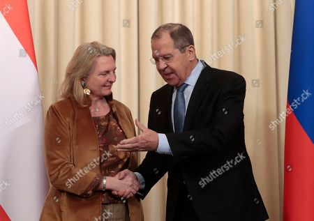 Austrian Foreign Minister Karin Kneissl (L) shakes hands with Russian Foreign Minister Sergei Lavrov (R) during a joint news conference following their meeting in Moscow, Russia, 12 March 2019. Kneissl is on a working visit in Moscow to discuss a wide range of bilateral issues and prospects in order to promote bilateral cooperation.