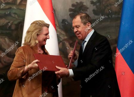 Austrian Foreign Minister Karin Kneissl (L) and Russian Foreign Minister Sergei Lavrov (R) exchange documents during a signing ceremony following their talks in Moscow, Russia, 12 March 2019. Austrian Foreign Minister Karin Kneissl is on a working visit in Moscow to discuss a wide range of bilateral issues and prospects in order to promote bilateral cooperation.