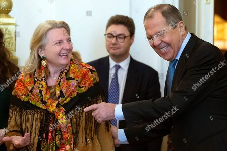 Sergey Lavrov, Karin Kneissl. Russian Foreign Minister Sergey Lavrov, right, gestures as he welcomes Austrian Foreign Minister Karin Kneissl for talks in Moscow, Russia