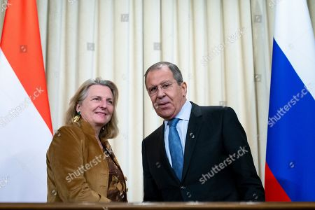 Sergey Lavrov, Karin Kneissl. Russian Foreign Minister Sergey Lavrov, right, and Austrian Foreign Minister Karin Kneissl pose for a photo after their talks in Moscow, Russia