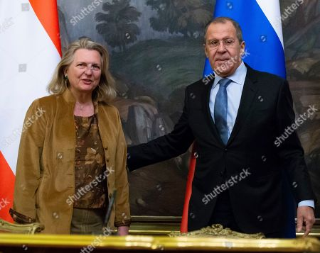 Sergey Lavrov, Karin Kneissl. Russian Foreign Minister Sergey Lavrov, right, and Austrian Foreign Minister Karin Kneissl pose for a photo after a signing ceremony followed their talks in Moscow, Russia