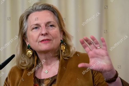 Austrian Foreign Minister Karin Kneissl gestures during a joint press conference with Russian Foreign Minister Sergey Lavrov following their talks in Moscow, Russia