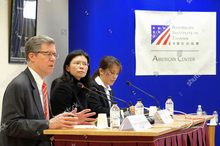 """Sam Brownback, U.S. ambassador-at-large for international religious freedom, left, sits near Lee Ching-yu, the wife of Taiwanese pro-democracy activist Lee Ming-che in Taipei, Taiwan, . Describing China's internment of an estimated 1 million Muslims as a """"horrific situation,"""" a U.S. envoy on religion called Tuesday for an independent investigation into the detentions and for the release of those being held"""