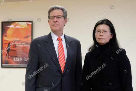"""Sam Brownback, U.S. ambassador-at-large for international religious freedom, left, stands with Lee Ching-yu, the wife of Taiwanese pro-democracy activist Lee Ming-che in Taipei, Taiwan, . Describing China's internment of an estimated 1 million Muslims as a """"horrific situation,"""" a U.S. envoy on religion called Tuesday for an independent investigation into the detentions and for the release of those being held"""
