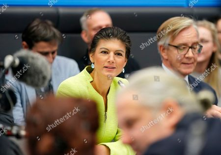 Sahra Wagenknecht (C), co-chairwoman of the parliamentary group of The Left (Die Linke) party in the Bundestag sits next to the co-chairman Dietmar Bartsch (2-R) opening the Bundestag faction meeting of The Left in Berlin, Germany, 12 March 2019. Wagenknecht announced on 11 March 2019 that she does not want to run for the position of chairwoman of the parliamentary group again. Earlier she quit the leadership of the German left-wing movement 'Stand Up' that she co-founded in September 2018. According to media reports, Wagenknecht is said to have given health reasons for the withdrawal from these two leading positions.