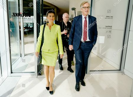 Sahra Wagenknecht (L), co-chairwoman of the parliamentary group of The Left (Die Linke) party in the Bundestag and co-chairman Dietmar Bartsch (R) walk to attend the faction meeting of The Left in Berlin, Germany, 12 March 2019. Wagenknecht announced on 11 March 2019 that she does not want to run for the position of chairwoman of the parliamentary group again. Earlier she quit the leadership of the German left-wing movement 'Stand Up' that she co-founded in September 2018. According to media reports, Wagenknecht is said to have given health reasons for the withdrawal from these two leading positions.