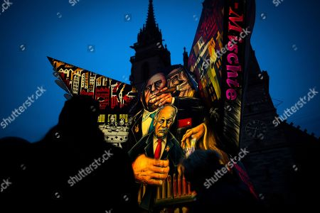 Stock Picture of A carnival lantern depicting Swiss federall councillor Johann Schneider-Ammann is on display on the Muensterplatz on the second day of carnival in Basel, Switzerland, on 12 March 2019.