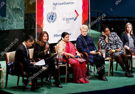 Stock Picture of (L-R) TV journalist Richard Lui, Marta Lucia Ramirez, Vice President of the Republic of Colombia, Bidya Devi Bhandari, President of Nepal, Dalia Grybauskaite, President of Lithuania, Paula-Mae Weekes O.R.T.T., President of the Republic of Trinidad and Tobago, and Federica Mogherini, High Representative of the European Union for Foreign Affairs and Security Policy, gather for a roundtable discussion during the high-level event 'Women in Power' in the General Assembly Hall at the United Nations headquarters in New York, New York, USA, 12 March 2019. The event gathered delegates from around the world to discuss women's roles in leadership positions and ways to address issues of gender inequity.
