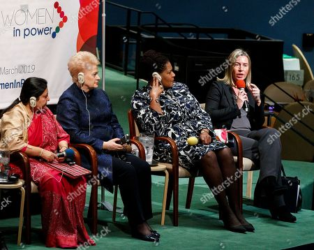 Stock Image of Federica Mogherini (R), High Representative of the European Union for Foreign Affairs and Security Policy, speaks with Bidya Devi Bhandari (L), President of Nepal, Dalia Grybauskaite (2-L), President of Lithuania, and Paula-Mae Weekes (2-R), President of the Republic of Trinidad and Tobago, listening in a roundtable discussion during the high-level event 'Women in Power' in the General Assembly Hall at the United Nations headquarters in New York, New York, USA, 12 March 2019. The event gathered delegates from around the world to discuss women's roles in leadership positions and ways to address issues of gender inequity.