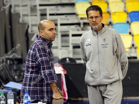 Herbalife Gran Canaria's new head coach Pedro Martinez (R) talks with former coach Victor Garcia (L) during a training session in Las Palmas de Gran Canaria, Canary Islands, Spain, 12 March 2019.