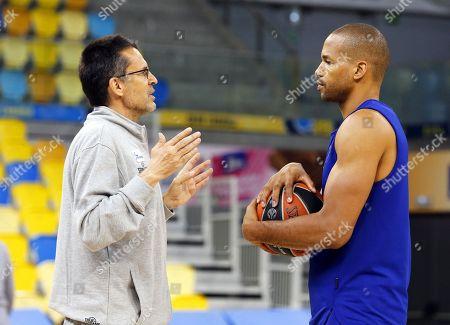 Herbalife Gran Canaria's new head coach Pedro Martinez (L) talks with Gran Canaria's captain Eulis Baez (R) during a training session in Las Palmas de Gran Canaria, Canary Islands, Spain, 12 March 2019.