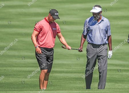 Martin Kaymer of Germany (L) and Vijay Singh of Fiji (R) look at a club as they walks on the second hole during practice for THE PLAYERS Championship golf tournament on the Stadium Course at TPC Sawgrass in Ponte Vedra Beach, Florida, USA, 12 March 2019. The tournament runs from 14 to 17 March.