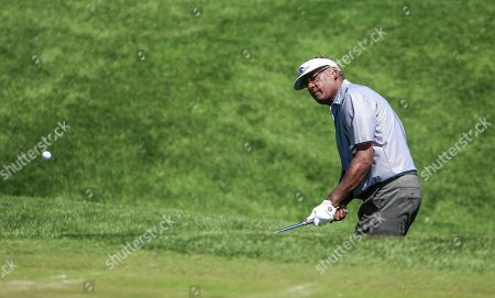 Vijay Singh of Fiji chips onto the second green during practice for THE PLAYERS Championship golf tournament on the Stadium Course at TPC Sawgrass in Ponte Vedra Beach, Florida, USA, 12 March 2019. The tournament runs from 14 to 17 March.