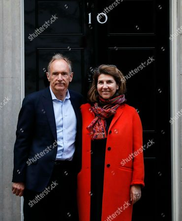 Sir Tim Berners-Lee, best known as the inventor of the World Wide Web, and his wife Rosemary stands on the steps of 10 Downing street after meeting to mark 30 years of the World Wide Web, in London