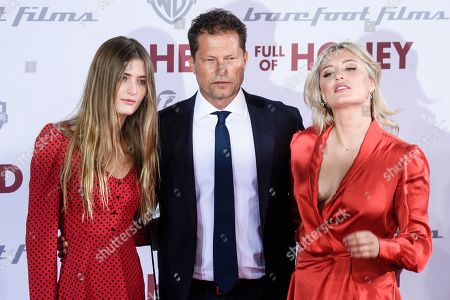 Til Schweiger (C) and his daughters, German actresses Lilli Schweiger (L), and Luna Schweiger (R) arrive for the European premiere of 'Head Full of Honey' in Berlin, Germany, 12 March 2019. The movie screens in German theaters from 21 March on.