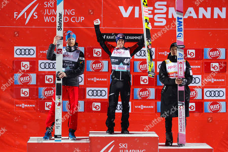 L-R: Second placed Robert Johansson Norway, first place Stefan Kraft of Austria and third placed Ryoyu Kobayashi of Japan  on the podium after FIS World Cup Ski Jumping Men competition at Lillehammer, 12 March 2019.