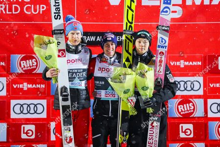 L-R: Second placed Robert Johansson Norway, first place, Stefan Kraft of Austria and third placed Ryoyu Kobayashi of Japan on the podium after FIS World Cup Ski Jumping Men competition at Lillehammer, 12 March 2019.