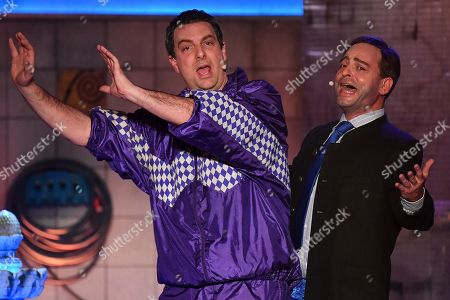 Stock Photo of German actor Stephan Zinner (L) as Bavarian state prime minister Markus Soeder and German actor Florian Fischer (R) as Hubert Aiwanger, Bavarian Minister of Economic Affairs and Deputy Prime Minister, perform during the traditional 'Politiker-Derblecken (Singspiel)' (lit.: Deriding of politicians (musical comedy)) on Nockherberg terrace in Munich, Germany, 12 March 2019. The satirical mocking, the 'Derblecken' of politicians, traditionally opens strong beer season in Bavaria.