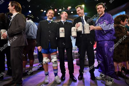 (L-R) German actor Florian Fischer, Bavarian Minister of Economic Affairs and Deputy Prime Minister Hubert Aiwanger, Bavarian state prime minister Markus Soeder and German actor Stephan Zinner pose for a picture after the traditional 'Politiker-Derblecken (Singspiel)' (lit.: Deriding of politicians (musical comedy)) on Nockherberg terrace in Munich, Germany, 12 March 2019. The satirical mocking, the 'Derblecken' of politicians, traditionally opens strong beer season in Bavaria.