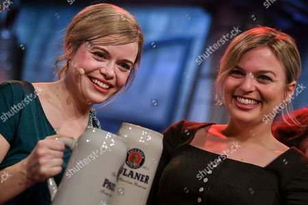 German actress Sina Reiss (L) as Bavarian Alliance 90/The Greens party fraction leader Katharina Schulze, and Bavarian Alliance 90/The Greens party fraction leader Katharina Schulze (R) pose after the traditional 'Politiker-Derblecken (Singspiel)' (lit.: Deriding of politicians (musical comedy)) on Nockherberg terrace in Munich, Germany, 12 March 2019. The satirical mocking, the 'Derblecken' of politicians, traditionally opens strong beer season in Bavaria.