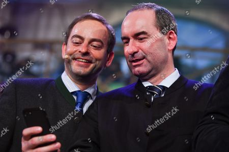 Stock Picture of German actor Florian Fischer (L) as Hubert Aiwanger, Bavarian Minister of Economic Affairs and Deputy Prime Minister, and Bavarian Minister of Economic Affairs and Deputy Prime Minister Hubert Aiwanger (R) take a selfie after the traditional 'Politiker-Derblecken (Singspiel)' (lit.: Deriding of politicians (musical comedy)) on Nockherberg terrace in Munich, Germany, 12 March 2019. The satirical mocking, the 'Derblecken' of politicians, traditionally opens strong beer season in Bavaria.