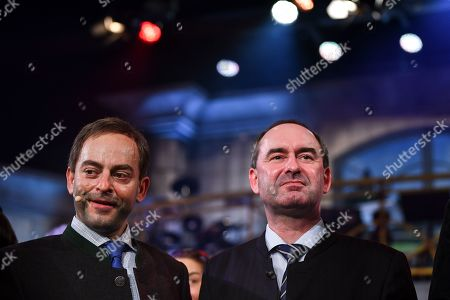 German actor Florian Fischer (L) as Hubert Aiwanger, and Bavarian Minister of Economic Affairs and Deputy Prime Minister Hubert Aiwanger pose after the traditional 'Politiker-Derblecken (Singspiel)' (lit.: Deriding of politicians (musical comedy)) on Nockherberg terrace in Munich, Germany, 12 March 2019. The satirical mocking, the 'Derblecken' of politicians, traditionally opens strong beer season in Bavaria.