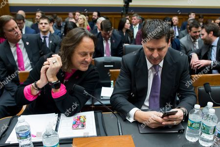 CEO of T-Mobile John Legere (L) and Executive Chairman of Sprint Marcelo Claure (R) look at a cell phone before they testifiy at a House Judiciary subcommittee hearing on 'The State of Competition in the Wireless Market: Examining the Impact of the Proposed Merger of T-Mobile and Sprint on Consumers, Workers, and the Internet', on Capitol Hill in Washington, DC, USA, 12 March 2019. Critics of the proposed multi-billion US dollar merger between T-Mobile and Sprint say it would negatively impact the variety and number of jobs in the market.