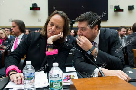 CEO of T-Mobile John Legere (L) and Executive Chairman of Sprint Marcelo Claure (R) speak with one another before testifiying at a House Judiciary subcommittee hearing on 'The State of Competition in the Wireless Market: Examining the Impact of the Proposed Merger of T-Mobile and Sprint on Consumers, Workers, and the Internet', on Capitol Hill in Washington, DC, USA, 12 March 2019. Critics of the proposed multi-billion US dollar merger between T-Mobile and Sprint say it would negatively impact the variety and number of jobs in the market.