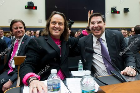 CEO of T-Mobile John Legere (L) and Executive Chairman of Sprint Marcelo Claure (R) pose for pictures before testifiying at a House Judiciary subcommittee hearing on 'The State of Competition in the Wireless Market: Examining the Impact of the Proposed Merger of T-Mobile and Sprint on Consumers, Workers, and the Internet', on Capitol Hill in Washington, DC, USA, 12 March 2019. Critics of the proposed multi-billion US dollar merger between T-Mobile and Sprint say it would negatively impact the variety and number of jobs in the market.