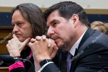 Executive chairman of Sprint Marcelo Claure (R) and CEO of T-Mobile John Legere (L) appear before a House Judiciary subcommittee hearing on 'The State of Competition in the Wireless Market: Examining the Impact of the Proposed Merger of T-Mobile and Sprint on Consumers, Workers, and the Internet', on Capitol Hill in Washington, DC, USA, 12 March 2019. Critics of the proposed multi-billion US dollar merger between T-Mobile and Sprint say it would negatively impact the variety and number of jobs in the market.