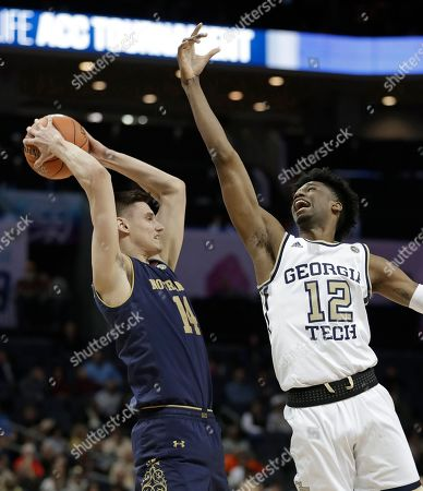 Notre Dame's Nate Laszewski (14) grabs a rebound in front of Georgia Tech's Khalid Moore (12) during the first half of an NCAA college basketball game in the Atlantic Coast Conference tournament in Charlotte, N.C