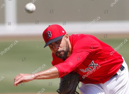Boston Red Sox starting pitcher David Price delivers a pitch in the second inning of a spring training baseball game against the Detroit Tigers, in Fort Myers, Fla