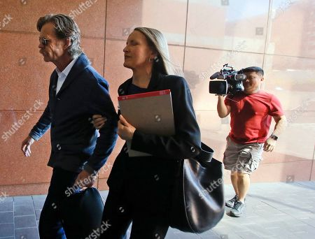 Actor William H. Macy arrives at the federal courthouse in Los Angeles, on . Fifty people, including Macy's wife, actress Felicity Huffman and actress Lori Loughlin, were charged Tuesday in a scheme in which wealthy parents allegedly bribed college coaches and other insiders to get their children into some of the nation's most elite schools. Macy was not charged; authorities did not say why