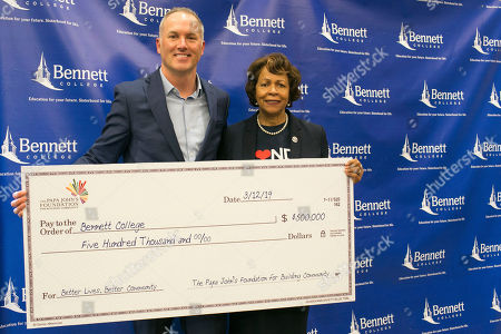 IMAGE DISTRIBUTED FOR PAPA JOHN's - Papa John's President and CEO Steve Ritchie stands next to Dr. Phyllis Worthy Dawkins president of Bennett College, one of two Historically Black Colleges for women in the United States, where the Papa John's Foundation provided a $500,000 grant at the college on in Greensboro, N.C