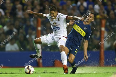 Boca Juniors' Ivan Marcone (R) vies for the ball with Deportes Tolima's Larry Vasquez during their Copa Libertadores group G soccer match between Boca Juniors and Deportes Tolima, at La Bombonera stadium in Buenos Aires, Argentina, 12 March 2019