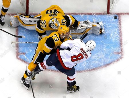 Washington Capitals' Alex Ovechkin (8) can't get a shot past Pittsburgh Penguins goaltender Matt Murray (30) with Jack Johnson (73) defending during the first period of an NHL hockey game in Pittsburgh, . The Penguins won 5-3