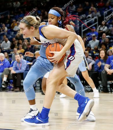 DePaul guard Kelly Campbell, front, steals the ball from Marquette guard Danielle King during the first half of an NCAA college basketball game in the Big East women's tournament final, in Chicago