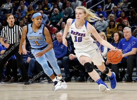 DePaul guard Lexi Held (10) drives to the basket past Marquette guard Danielle King (1) during the second half of an NCAA college basketball game for the Big East women's tournament title, in Chicago
