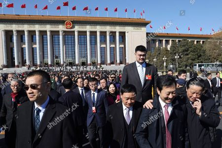 Delegates including former NBA basketball player Yao Ming, file out of the Great Hall of the People after the closing ceremony of the Chinese People's Political Consultative Conference (CPPCC) in Beijing, China
