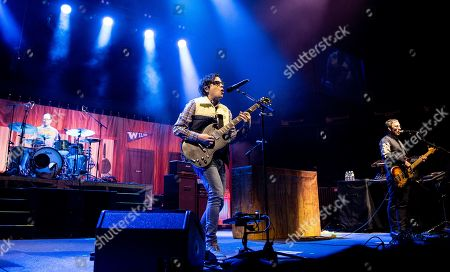 Patrick Wilson, Rivers Cuomo, and Scott Shriner of Weezer