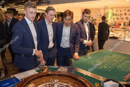 Stock Photo of Georg Teigl #34 (FC Augsburg), Fredrik Jensen #24 (FC Augsburg), Ja-Cheol Koo #19 (FC Augsburg), Jeffrey Gouweleeuw #6 (FC Augsburg), Casino Night FC Augsburg,, 13.03.2019