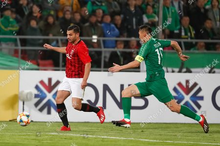 Andrew Nabbout (L) of Urawa Reds vies for the ball with Yu Dabao (R) of Beijing Guoan during the AFC Champions League group stage soccer match between Beijing Guoan and Urawa Reds at the Workers Stadium in Beijing, China, 13 March 2019.