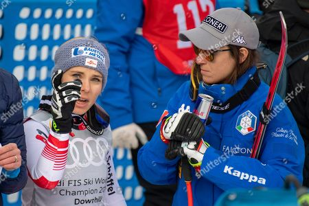 Nicole Schmidhofer of Austria (L) and Sofia Goggia of Italy react in the finish area during the Women's Downhill race of the FIS Alpine Skiing World Cup finals in Soldeu-El Tarter, Andorra, 13 March 2019.