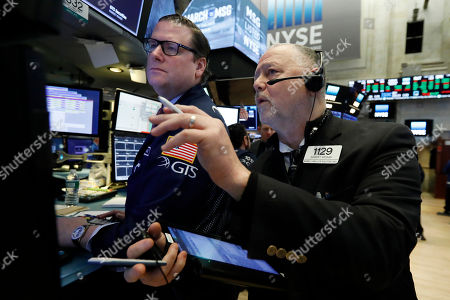 Gregg Maloney, Robert Moran. Specialist Gregg Maloney, left, and trader Robert Moran work on the floor of the New York Stock Exchange, . U.S. stocks opened broadly higher on Wall Street Wednesday, powered by technology and health care companies, as the market pushes for its third straight day of gains