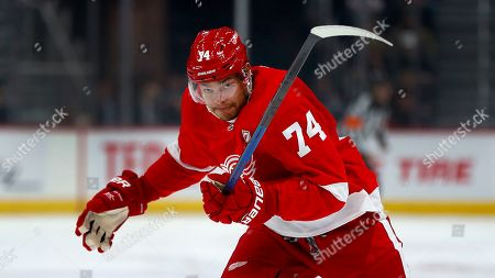 Detroit Red Wings defenseman Madison Bowey chases the puck during a moment of silence for Ted Lindsay before an NHL hockey game, in Detroit